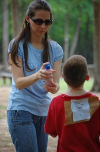 applying a natural mosquito repellent