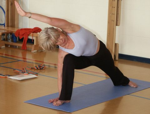 Yoga stretches - You can do yoga exercises at home alone or in a class with an instructor