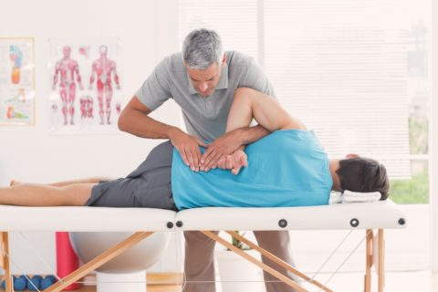 A manual adjustment involves the chiropractor putting their hands somewhere on your spine to force some movement.