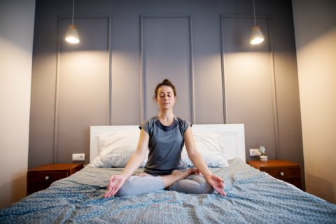 This is an example of the Seated Meditation pose - simple yoga exercises for easy yoga in bed.