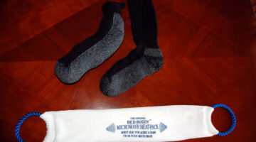 You can use a sock filled with rice to make your own microwave heating pad! photo by Lynnette at TheFunTimesGuide.com