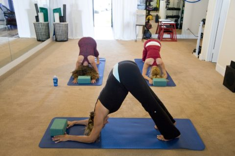 you can do yoga stretches in a small class or a large class